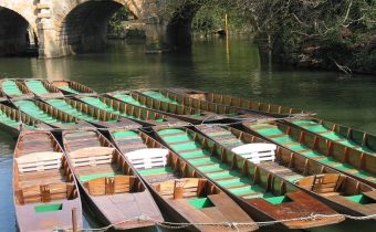 Punts tethered by Magdalen Bridge in Oxford