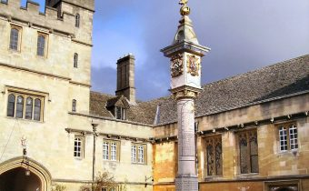 The main quadrangle at Corpus Christi Collge in Oxford, with its famed sundial pillar